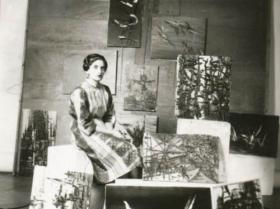 Soshana with painting wearing a Sari | Paris 1957