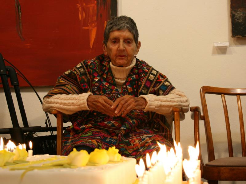 Soshana in front of birthday cake